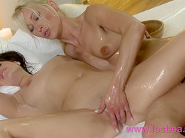 Oiled blonde slides all over busty UK lesbian in erotic massage