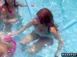 Teens at pool orgy party outdoors-