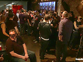 Captured stud is being used in a bar full of horny masked men
