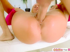 Innocent looking girl masturbates and probes by a big dick