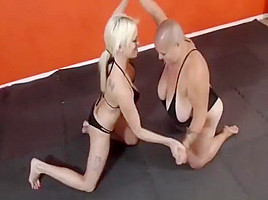 Fat bald girl wrestling with an athletic slim girl