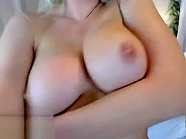 Busty blonde shows her big tits