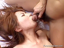 Eager to Satisfy her two Lovers this Sexy Japanese Teen is Fucked in her Hairy Pussy by the Sex Toy one holds before she Sucks Licks and Devours both Cocks in a Wet Sloppy Double Blowjob