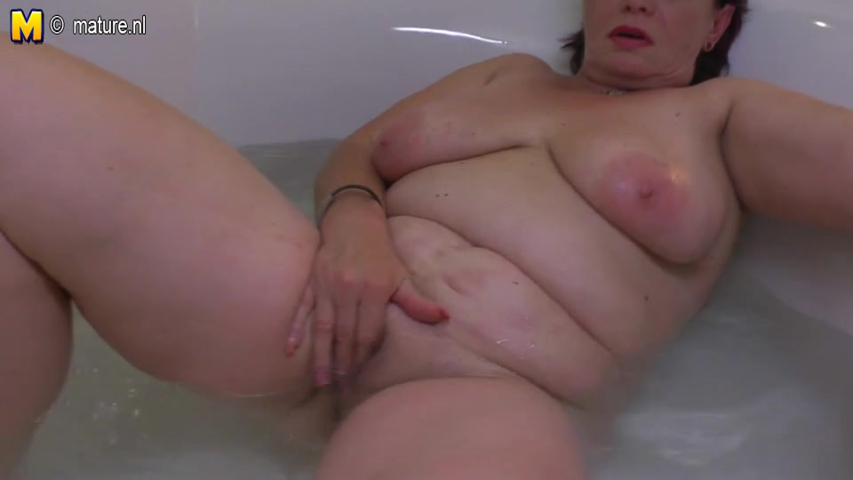 Chic dilettante granny playing in the washroom red tube granny cum