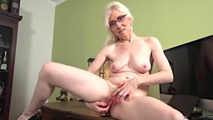 mature blonde solo masturbation on a desk Busty milf fingering