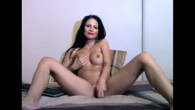 Woman Playing With Her Dildoes