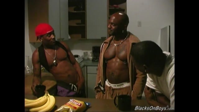 Three black dudes sharing a muscular guy Mia Fortune drills in the kitchen