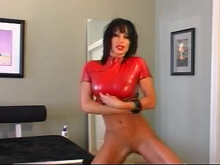 Brunette cunt dressed in red presents her latex fetish