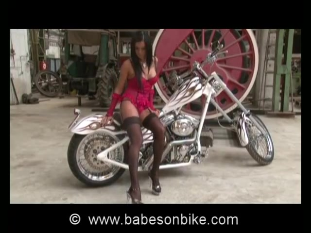 Naked dame is nasty on bike