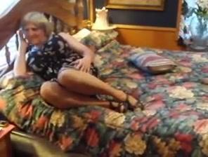 Crossdresser on her bed German army men