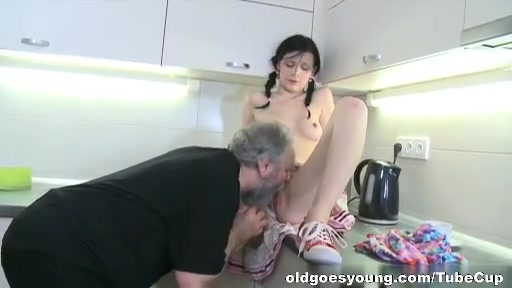 Karina kneels before both of her men and takes their cum all over her mouth and tits. Hot plump milf pic