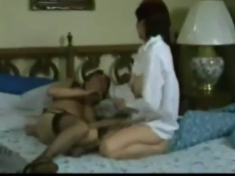 Retro moms wrestle in bed