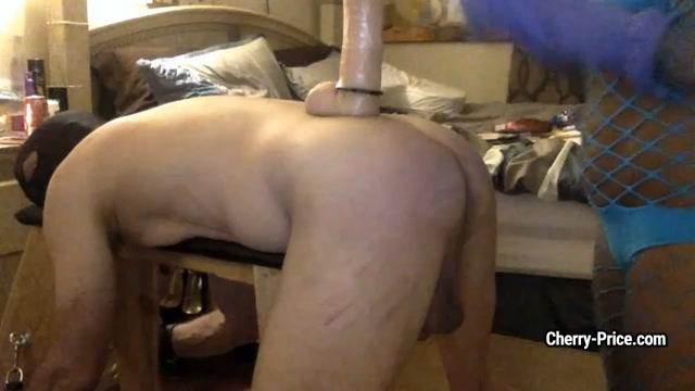 Strict black mistress fucks slaves asshole with huge dildo