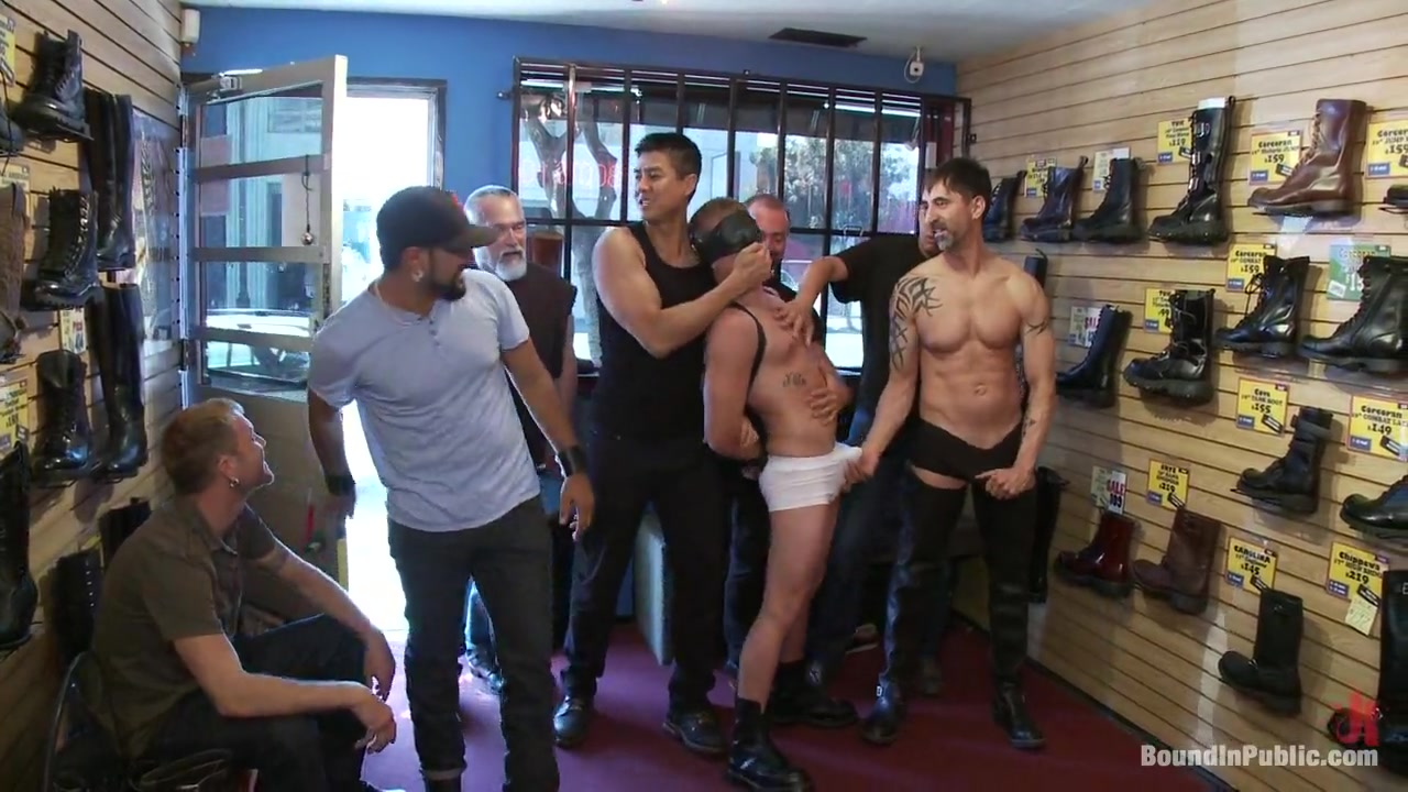 Bound in Public. Use and humiliate a blond stud at Stompers Boots sucking daddys big cock