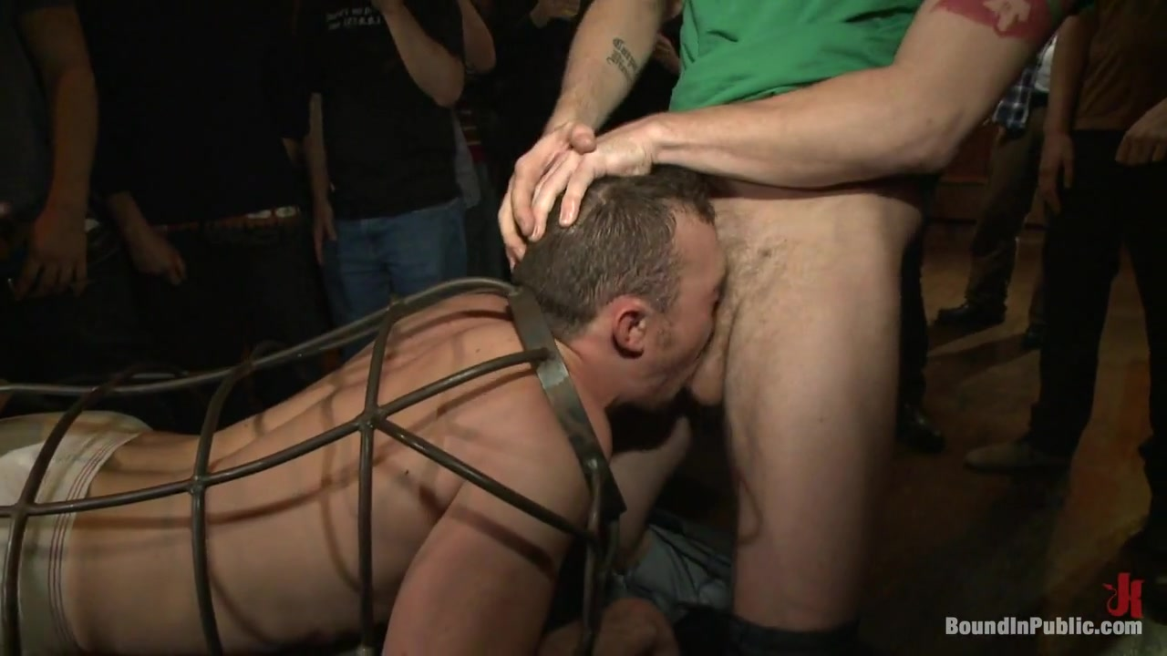 Bound in Public. Stud in a metal cage is fucked by horny bar patrons Huge Cock Gaping Pussy