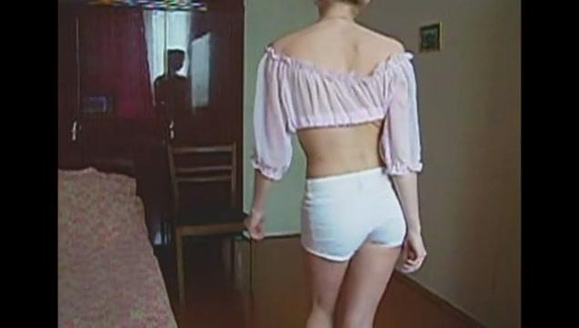 junior girl dances a striptease with a tulle