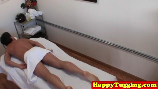 Asian masseuse jerks client cock for cash
