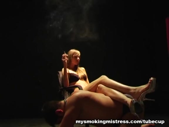 Smoking Lady Relaxing on Slave