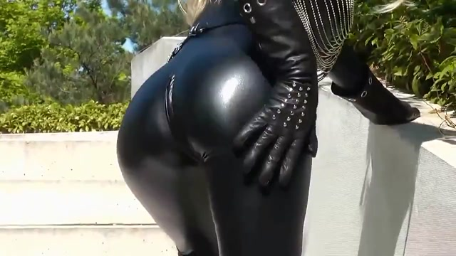 Sexy blonde lady black leather catsuit