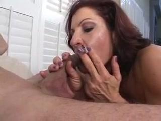 Sexy older brunette hair masterfully sucks knob whilst smokin a cigarette
