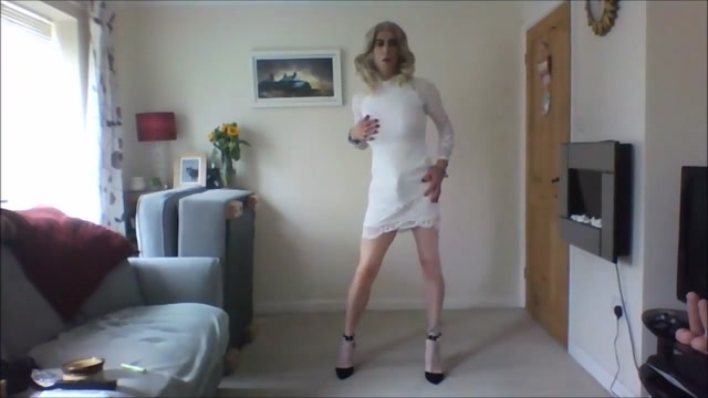 Crossdresser in white minidress best sex positions for people in their 60s
