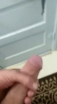 Jerking cock in bathroom