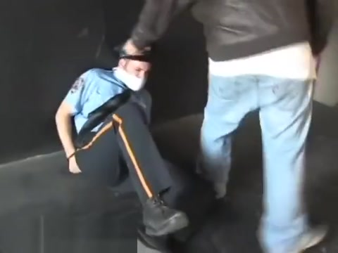 BG Cop handcuffed gagged and hogtied. feet in a cubic foot
