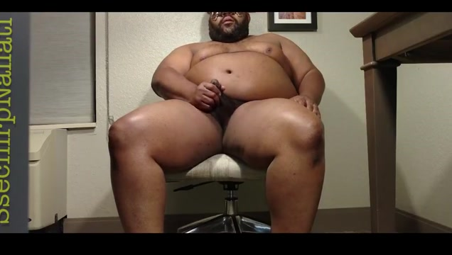 A Black Man In A Small Tan Desk Chair Black cock infatuation