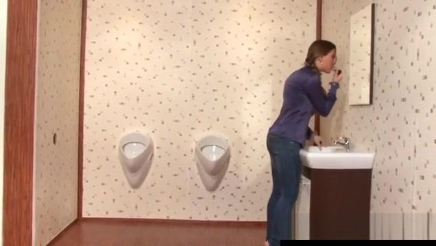 Classy girl sucks dick at toilet gloryhole