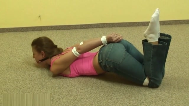 Girl in jeans bound and ballgagged