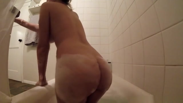 Busty Brett Rossi takes a bath