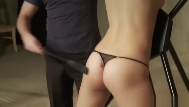 Sexy brunette is tied down for a good hard spanking