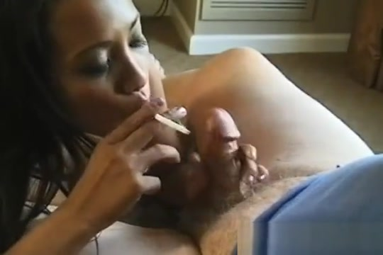 This Wench Shows Her Huge Bust While Holding A Cigarette