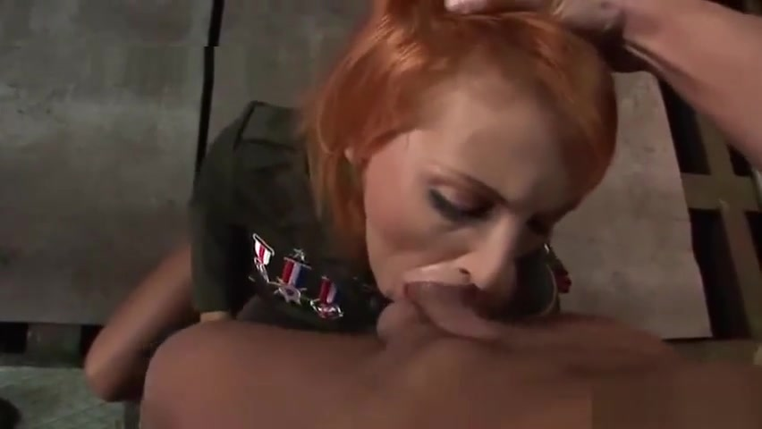 Sexy redhead army babe sucking and tugging a cock New look and new character
