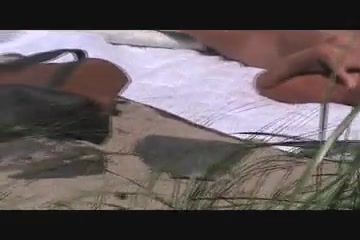 voyeur catches MILF on a beach