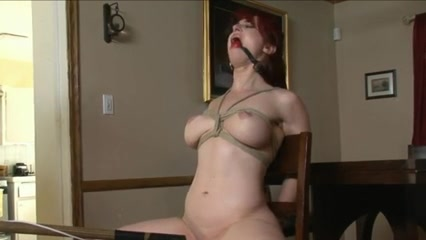 Tied and gagged redhead toyed on a chair in her tight butt